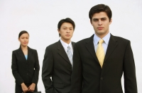 Business people standing, looking at camera, in a row - Alex Mares-Manton