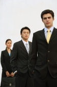Business people standing in a row - Alex Mares-Manton