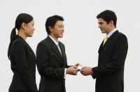 Business people exchanging name cards - Alex Mares-Manton