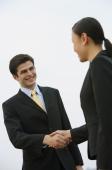 Businessman and businesswoman shaking hands - Alex Mares-Manton