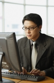 Businessman using computer - Alex Mares-Manton