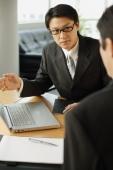 Businessmen having a discussion - Alex Mares-Manton