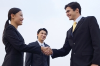 Businesspeople shaking hands - Alex Mares-Manton