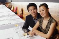 Couple sitting in restaurant, smiling at camera - Alex Mares-Manton