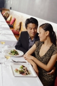Couple sitting side by side in restaurant - Alex Mares-Manton
