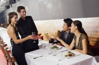 Couples in restaurant, toasting with wine glasses - Alex Mares-Manton