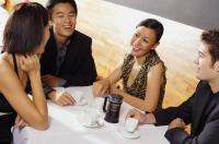 Couples sitting in restaurant, having coffee - Alex Mares-Manton