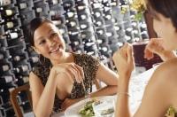 Women having a meal in restaurant - Alex Mares-Manton