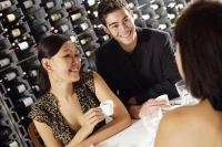 Young adults having coffee in restaurant - Alex Mares-Manton