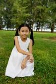 Girl in white dress, crouching on grass - Yukmin