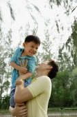 Father lifting son - Yukmin