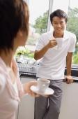 Couple having coffee in kitchen - Alex Mares-Manton