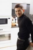 Man in kitchen, looking at camera - Alex Mares-Manton