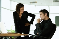 Businesswoman having a serious discussion with businessman - Alex Mares-Manton