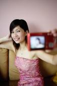 Woman using camera to take photo of herself - Yukmin