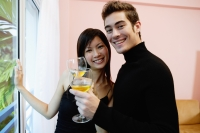 Couple with wine glasses, smiling at camera - Yukmin