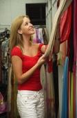 Caucasian woman in cloth shop, shopping - Alex Microstock02