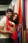 Couple in clothes shop, looking at camera - Alex Microstock02