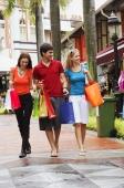 Caucasian tourists walking around Arab street, Singapore - Alex Microstock02