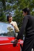 Man opening car door for woman - Alex Mares-Manton