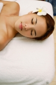 Young woman massage table, eyes closed, head shot - Alex Microstock02