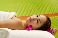 Young woman lying on massage table - Alex Microstock02
