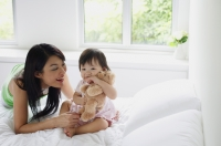 Mother bonding with young daughter - Alex Mares-Manton