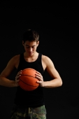 Man looking down at basketball in hands - Alex Microstock02