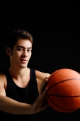Man holding basketball, looking at camera - Alex Microstock02