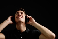 Man with headphones, listening to music, looking up - Alex Microstock02