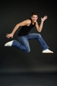 Man jumping in mid air, smiling at camera - Alex Microstock02
