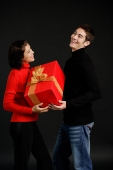 Man passing gift to woman - Alex Microstock02