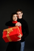 Woman holding gift, man embracing her - Alex Microstock02