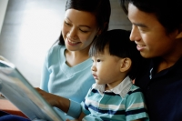 Family with one child reading a book - Alex Microstock02