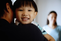Young boy looking over father's shoulder - Alex Microstock02
