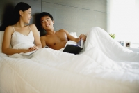 Couple in bed, with book and magazine - Alex Mares-Manton