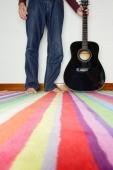 Man standing next to guitar, low section - Yukmin