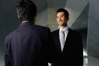 Two businessmen shaking hands, over the shoulder view - Yukmin