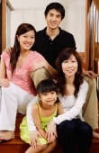 Three generation family sitting on stairs, portrait - Alex Mares-Manton