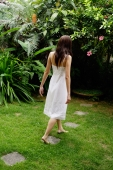 Woman in white dress walking in garden - Alex Mares-Manton