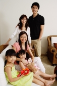 Three generation family looking at camera - Alex Mares-Manton