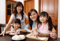 Three generations of females, in kitchen, smiling at camera - Alex Mares-Manton