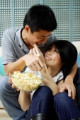 Woman feeding man popcorn - Alex Mares-Manton