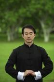 Man in park, meditating - Alex Mares-Manton