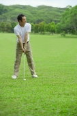 Man preparing to drive golf ball - Alex Mares-Manton