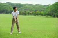 Mature man playing golf - Alex Mares-Manton