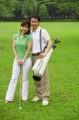 Couple on golf course, looking at camera - Alex Mares-Manton