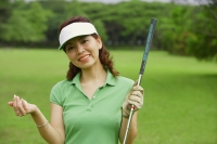 Female golfer smiling at camera - Alex Mares-Manton