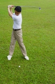 Man swinging golf club - Alex Mares-Manton