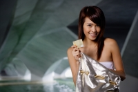 Woman holding gold credit card - Yukmin